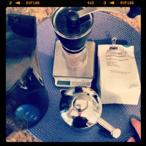 Hand grinder, scale, french press, and Anchored Coffee