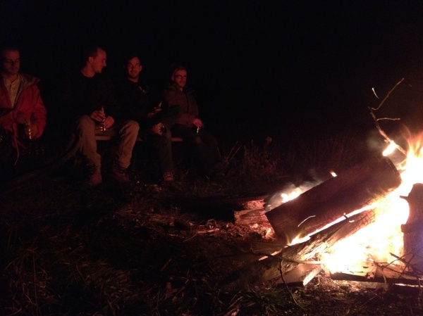 By the fire.